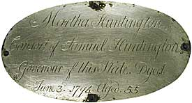 The medallion from Martha Huntington's coffin was cleaned up and attched to the new coffin.